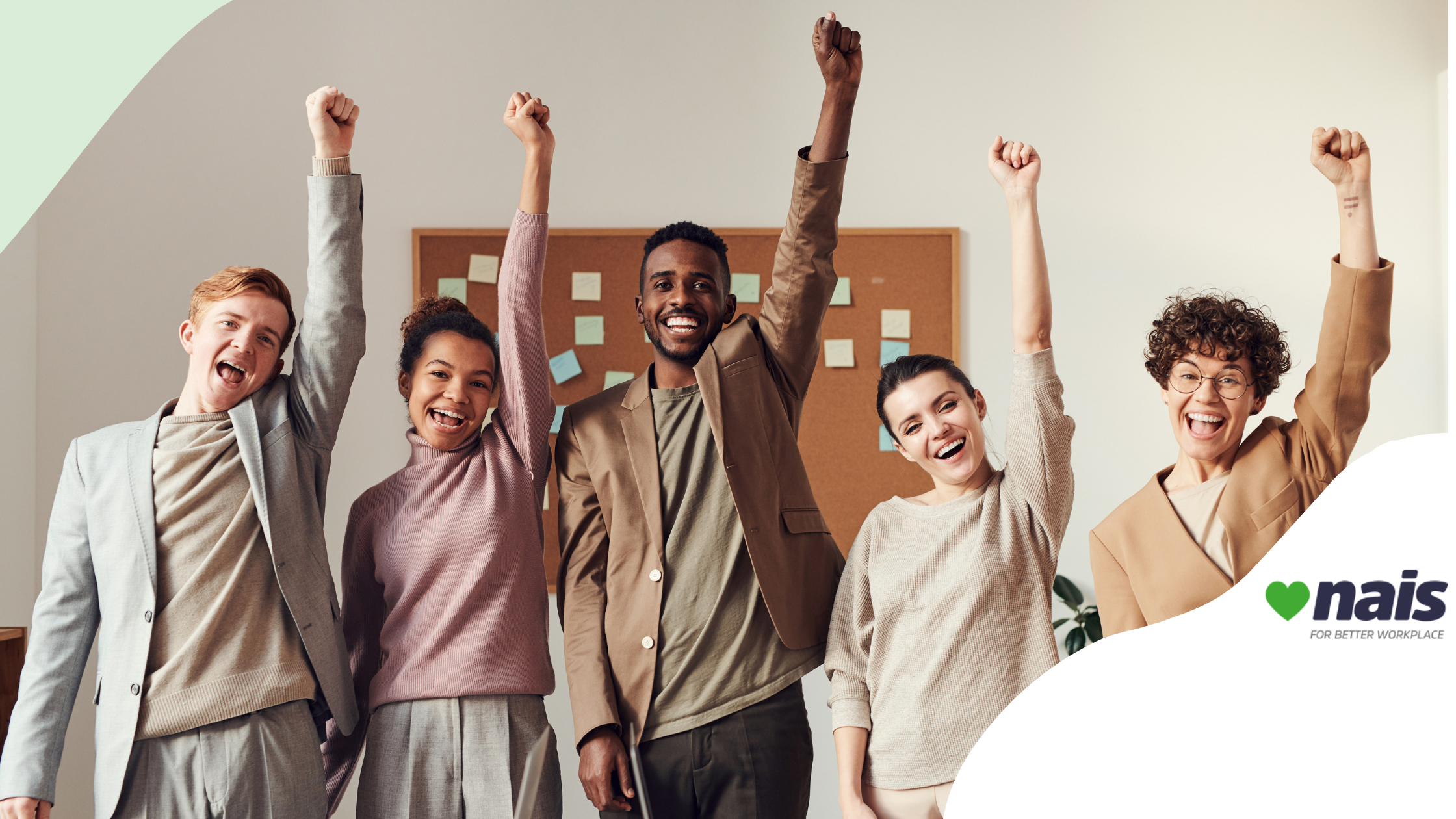 People raising their arms up in the air and smiling in an office