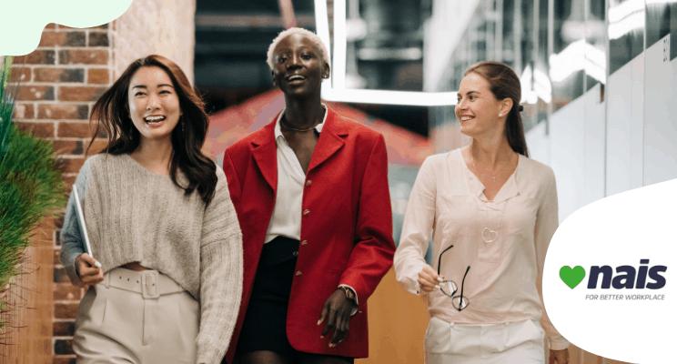 Three woman smiling and walking